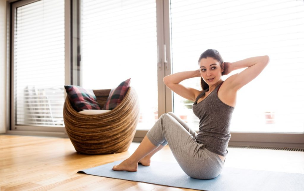 woman stretching during home exercise program