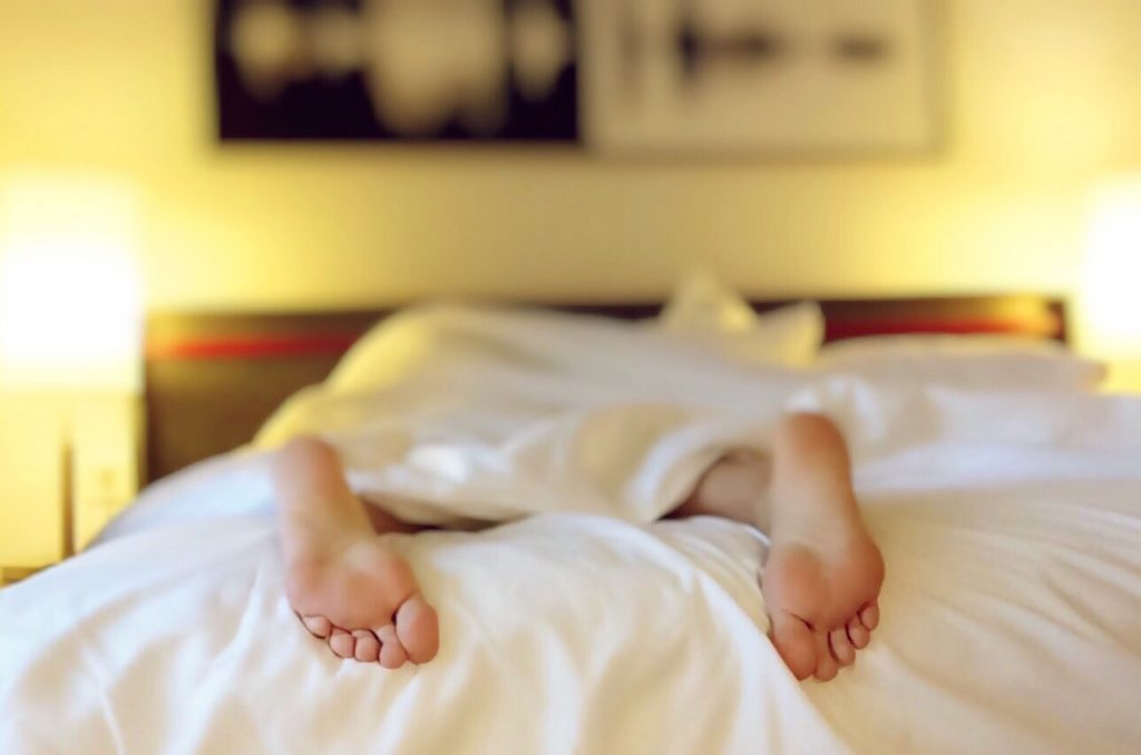 Person in bed, trying to sleep with Seasonal Affective Disorder